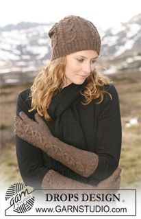 """Set comprises: Knitted DROPS hat and gloves with cables in """"Fabel"""". ~ DROPS Design"""