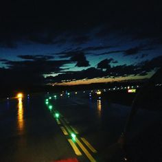 Bright lights and moody skies #aviation #avgeek #femalepilot #goodvibes #sky #clouds #sunset #dash8 #q400 #instagramaviation #goodvibesonly #lovemyjob #flying #taxi #wet #skyline #bestview