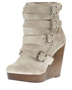 Chic with a towering wedge heel, I love the edgy buckle detailing.