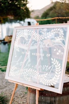kate weinstein; california wedding; Owl Creek Farms; outdoor wedding; outdoor reception; glass welcome sign with white calligraphy;