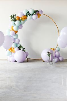Pastel coloured balloon arch in lilac, mint and gold with green and flower decorations. We used a matching gold balloon standard to fix the balloons in the round shape. Simple Balloon Decoration, Gender Reveal Party Decorations, Balloon Decorations Party, Flower Decorations, Church Christmas Decorations, Birthday Balloon Decorations, Birthday Balloons, Round Balloons, Colourful Balloons