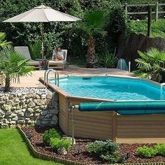 <body><p>Thoughtfully installed decking around the back half of this pool allows it to function like an in-ground design. The focal point of the landscaping is a dramatic rock retaining wall planted with palms, and a wood-plank surround that matches the deck yields a cohesive look.</p></body>