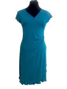 Turquoise feminine dress, for tango, summer and active living. Price Dkr 1000,-
