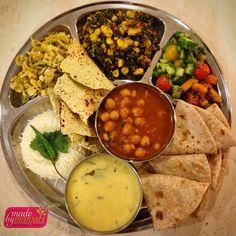 Diwali dinner! Happy New Year everyone! Tonight we feast! A traditional Indian thali consisting of Chana Masala, wilted ginger cabbage, curried corn, kale and paneer, basmati rice, yogurt kadhi, roti, papadam, a small side salad and pear and mango pickle!!! #madebymanjari #happydiwali #indian #newyear #yummy #yvr #instafood #instagood #dinner #food #foodie #foodism #foodstagram #foodphotography #fresh #goveg #healthy #healthyeats #healthyfoodshare #cleaneats #vegetarian
