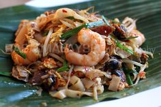 Char Kuey Teow (Spicy Penang Style Stir Fried Flat Noodles with Shrimp. Cockles & sausage are optional.)