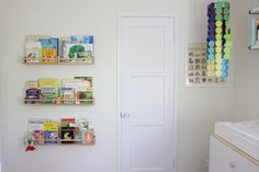 hang the fragile childrens' books up high until the kid is old enough not to tear them to shreds