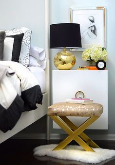 """Mallory Shaw of blog """"Confetti & Stripes"""" uses a gold X-bench in her bedroom alongside a sophisticated combo of black-and-white furnishings."""
