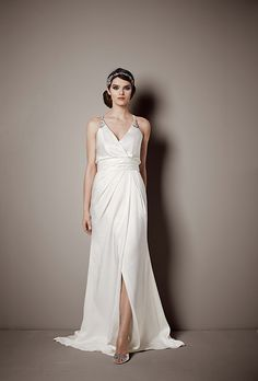 Brides.com: . Style SRL642, V-neck sheath with leg slit, $750, Galina Signature Collection available exclusively at David's Bridal