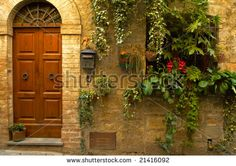 Walls and flowers in villages in Tuscany region of Italy.