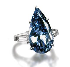 Bvlgari Blue Diamond Ring has 11 carat vivid blue center stone flanked with 9.87 carats of triangle colorless diamonds.
