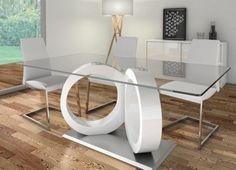 Mesa de comedor moderna, base metálica y diseño con forma de aros, lacados en blanco y tapa de cristal templado.