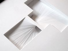 180 Hand-cut Paper Layers to form Letter Sculptures › Illusion