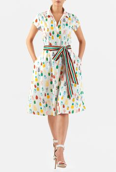 Our fun pineapple print shirtdress is cinched in at the seamed waist with a colorful stripe trapunto stitch sash tie belt for feminine flattery.
