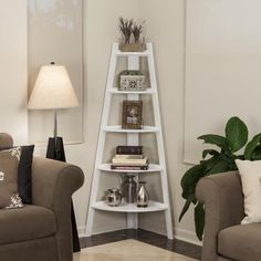 This contemporary Wood Corner Ladder Bookcase features a unique space-saving design that easily fits in the corners of most rooms. Its ladder style with descending shelves is ideal for displaying photo frames, books, and other collectibles. Bed Bath & Beyond, Corner Bookshelves, Ladder Bookcase, Corner Shelves Living Room, White Corner Shelf, Corner Ladder Shelf, Corner Shelf Design, Wooden Corner Shelf, Bookshelf Design