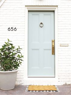 12 Front Doors That Make the Case for a Fresh Coat of Paint Make a knockout first impression with one of our these front door paint color ideas. Cottage Front Doors, Grey Front Doors, House Front Door, Painted Front Doors, House Doors, Front Door Decor, Cottage Windows, Exterior Door Colors, Front Door Paint Colors