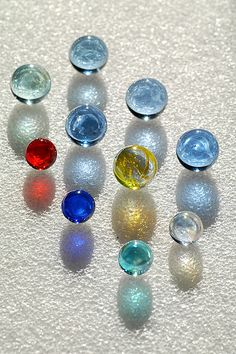 Glass marbles and their shadows