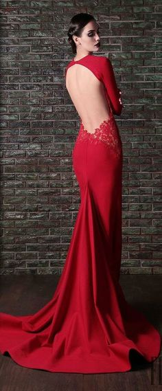 Yes, this dress is what I would describe as class on heels. A magnificent color red, an open back, with lacey embellishments, on the bottom part of the opening and a stunning train. A winner of winners !!!!!