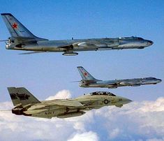 US Navy F-14 Tomcat escorting a pair of Tupolev Tu-16 bombers. F-14 Tomcat, Us Navy, Fighter Jets, Aircraft, Pairs, Vehicles, Aviation, Car, Planes