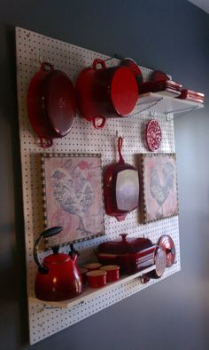 my wonderful husband made me pegboard le creuset display!