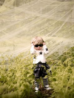 Katrina Tang Photography for Babesta Boutique NY AW 13. Baby standing in a magical forest, holding dark sunglasses, curtains #katrinatang #tangkatrina