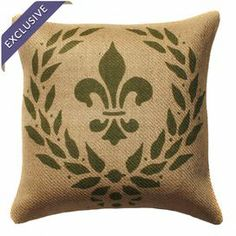 """Burlap pillow with a fleur-de-lis motif. Handmade in the USA.  Product: PillowConstruction Material: 100% Burlap cover and polyester fill Color: Natural and greenFeatures:      Zipper enclosureHandmade by TheWatsonShopMade with eco-friendly inks Insert includedMade in the USADimensions: 16"""" x 16""""  Cleaning and Care: Spot clean only"""