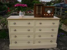 Pine chest of drawers, painted in Buttermilk Cream milk paint. The beech knobs have been decorated with assorted vintage bicycle images.