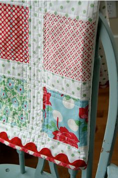 love the colors, red gingham binding and the ric rac  -  baby girl quilt by lullaby lucy, via Flickr