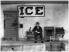 "Taken by Russell Lee for the Farm Security Administration, this photo from February of 1939 shows a Harlingen, Texas ""ice house"". Our intrepid ice man is surrounded with the tools of his trade, including a telephone that was already obsolete in Vintage Photographs, Vintage Photos, Vintage Signs, Shorpy Historical Photos, Rio Grande Valley, Ice Houses, Dust Bowl, Texas History, Family History"