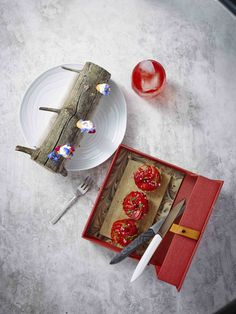 Chef Morten Falk (Kadeau) prepared this dessert consisting of a pie with Danish rhubarbs, strawberries, and elder to the right. To the left; waffles with ice cream, goat fraiche, and lemon.  Served with the Kay Bojesen cake fork.  Kay Bojesen Grand Prix cutlery. Danish Design.