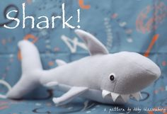 Shark PDF Sewing Pattern - Perfect for Your Little Pirate! Despite his fierce appearance, this shark is actually a soft and huggable toy! With this pattern you'll be able to sew up special handmade sharks for all the pirates in your life! This shark's mouth is open and full of white felt teeth. You can stick your hand inside his mouth, which functions like a soft pocket, and bury little treasures in there!