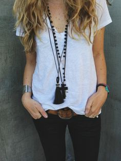 tassel necklace, skinny jeans, simple white T and leather belt.