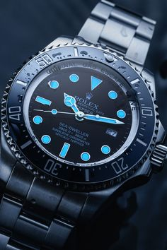 """The Rolex Sea-Dweller Deepsea (Ref. 116660) aka. """"James Cameron"""" comes with a dial that reminds of Cameron's dive to the deepest point on earth. The color gradient from blue to black is symbolic of the dive into the """"Challenger Deep"""" of the Mariana Trench. Moreover, the """"Deepsea"""" lettering has the same colour as the diving boat of the expedition - the """"Trieste"""". With a water resistance of up to 3,900 meters (12,800 feet), the Deepsea is one of Rolex's most extreme watches. Deepsea Challenger, Luxury Watches, Rolex Watches, Challenger Deep, Mariana Trench, Buy Rolex, Used Rolex, Sea Dweller, Rolex Models"""
