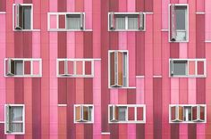 "This is the facade of one of the new buildings of the Eixample area of Vallecas in Madrid. Is processed to fit the title ""La Vie en Rose""."