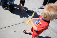Young Rocketeer  A young rocketeer, complete with a painted mask, gets ready to launch his very own stomp rocket at the Explore One booth at the StarLight Festival.