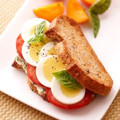 Tomato, hard boiled egg and basil sandwich
