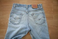 Vintage Levi Strauss red tab high waist denim jeans in womens waist size 33. Lots of rips, tears, and great faded color. tag marked made in usa Measures approximately: waist 33 hips 38.5 rise 11 inseam 30 length 40 vintage condition - lots of wear, fading, holes, and tears all over. holes/tears where inseam and rise meet --------------------------------------------------------- Vintage denim jacket, windbreakers, Patagonia and LLBean Fleece Jackets here: https://www.etsy...