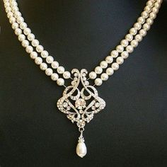 lovely gorgeous double string pearl necklace, pendant in the middle with a unique pearl drop design