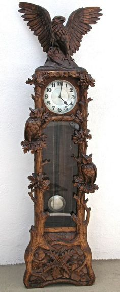 Circa 1900's Black Forest clock with hand carved forest scene with two fabulous glass eyed owls and an impressive eagle pediment. #WoodworkingClocks