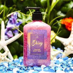 SHINY Shimmer Body Wash - $12.99 Wouldn't you rather be shiny like a treasure from a sunken pirate wreck? No need to be a drab little crab, now you can be as happy as a clam! Make yourself a work of art you'll never hide as glimmering suds of strawberry, sparkling champagne, crystal peonies and bright cassis make you shinier than ever before! Made with shimmer that washes off when used.