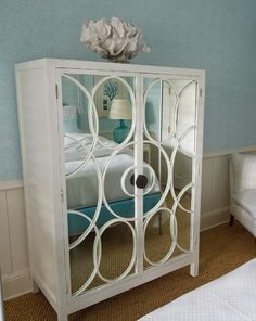 I totally love this chest/cabinet but with distressed mirrors - they are soooo beautiful and so much easier to live with.