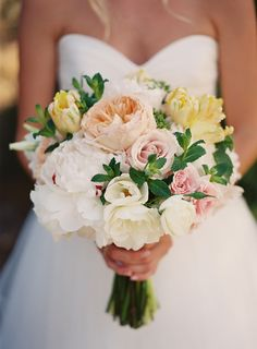 The brides beautiful bouquet of flowers.