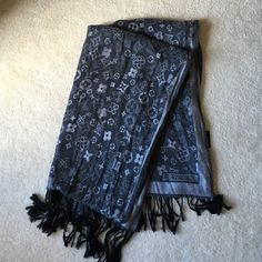 Louis Vuitton Scarf Charcoal and gray LV scarf. Received as a gift. Never worn. Louis Vuitton Accessories Scarves & Wraps