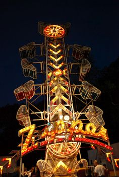 The first time I got on this ride was with my mom. She talked me into it and I was scared out of my mind. The damn thing starts and the cage is spinning and I'm about to fall out of it. All the while she's just a laughing, having a grand time. We got off the ride, I could barely walk, she couldn't stop laughing. :,)