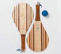Hardwood Paddle Ball ::  mix of walnut, teak, mahogany, purple heart and leather.