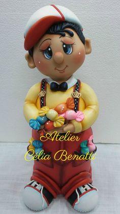 POTE MENINO BALINHA - Pote de 1.300 ml trabalhado em biscuit (porcelana fria) em forma de menino com balinhas. Este trabalho tem 34 cm de altura. Encomende o teu:  www.elo7.com.br/celiabenatti