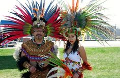 <small>A father and daughter in full regalia at Calpulli Tonalehqueh's Aztec/Mexica New Year ceremony.  They are members of the San Jose-based group Ehecatl Quetzalcoatl.</small>