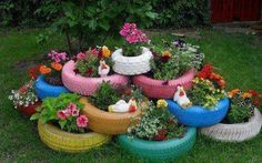 Great way to use old tires. Just spray paint & plant flowers in them!
