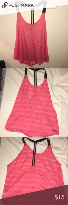 Nike tank top pink black racerback size XL Barely worn Nike tank top coral pink with black racerback straps and black Nike logo size XL Nike Tops Tank Tops