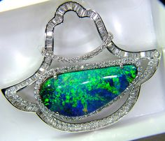 INVESTMENT 18K WHITE GOLD AND BOULDER OPAL PENDANT  77 CTS