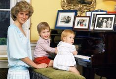 Playing the piano with Prince William and Prince Harry in Kensington Palace.